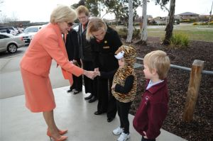 The Governor-General is met by kindergarten student, Amelia Justin.