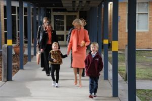 Kindergarten students Amelia Justin and Cooper McMaster accompany the Governor-General to the classroom.