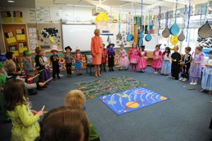 The kindergarten students perform a traditional welcome song from Mornington Island.