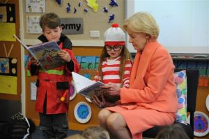 Kindergarten students Harry Neumann and Ava Singer read Book Week shortlisted book 'With Nan' to the Governor-General.