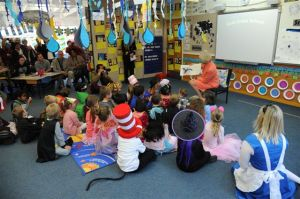 The Governor-General reads to the students.