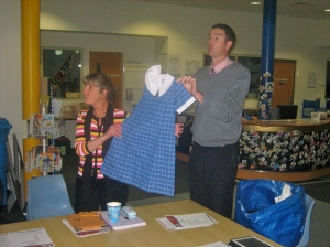 Principal Linda Baird and Associate Principal Grant Haigh display samples of the proposed new school uniform.